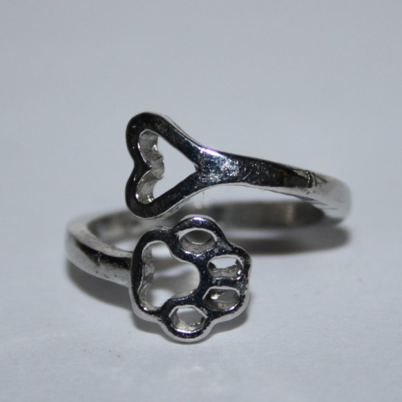 Silver bypass ring with paw and heart